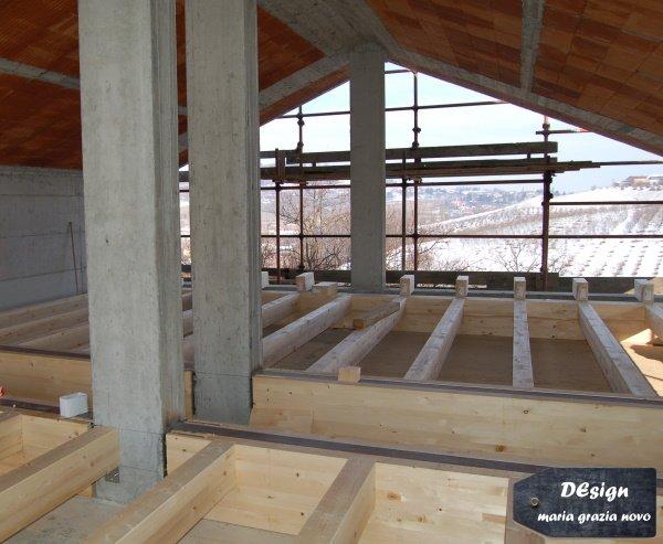 solaio in legno con vano scala e tetto a due falde in latero-cemento