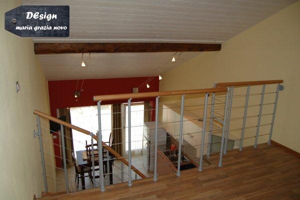 soppalco appartamento con tetto a vista in legno
