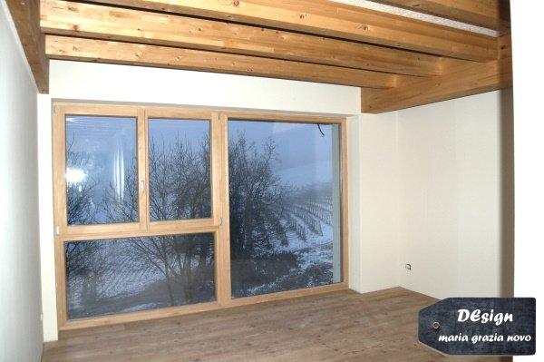 vetrata in legno con triplo vetro basso - emissivo camera padronale con soppalco