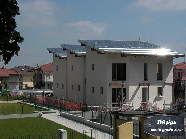 rasatura cappotto e impianto fotovoltaico sull'intera falda del tetto